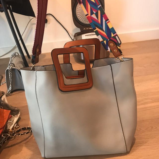 grey bag with double bag and shoulder strap