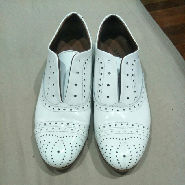 White patent leather shoes