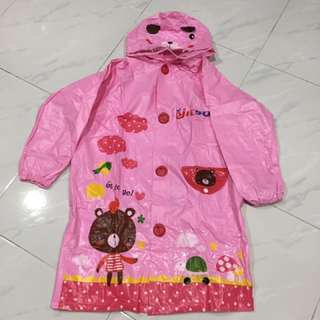 Kids raincoat with bag compartment
