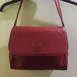Authentic red leather bag from London
