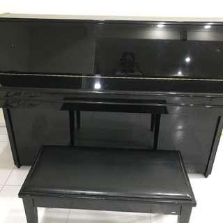 Yamaha upright piano (M108)