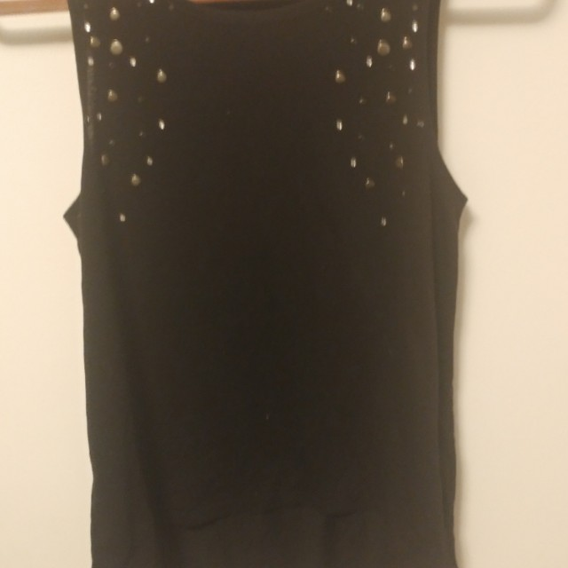 Black tank top with cut out skull on back