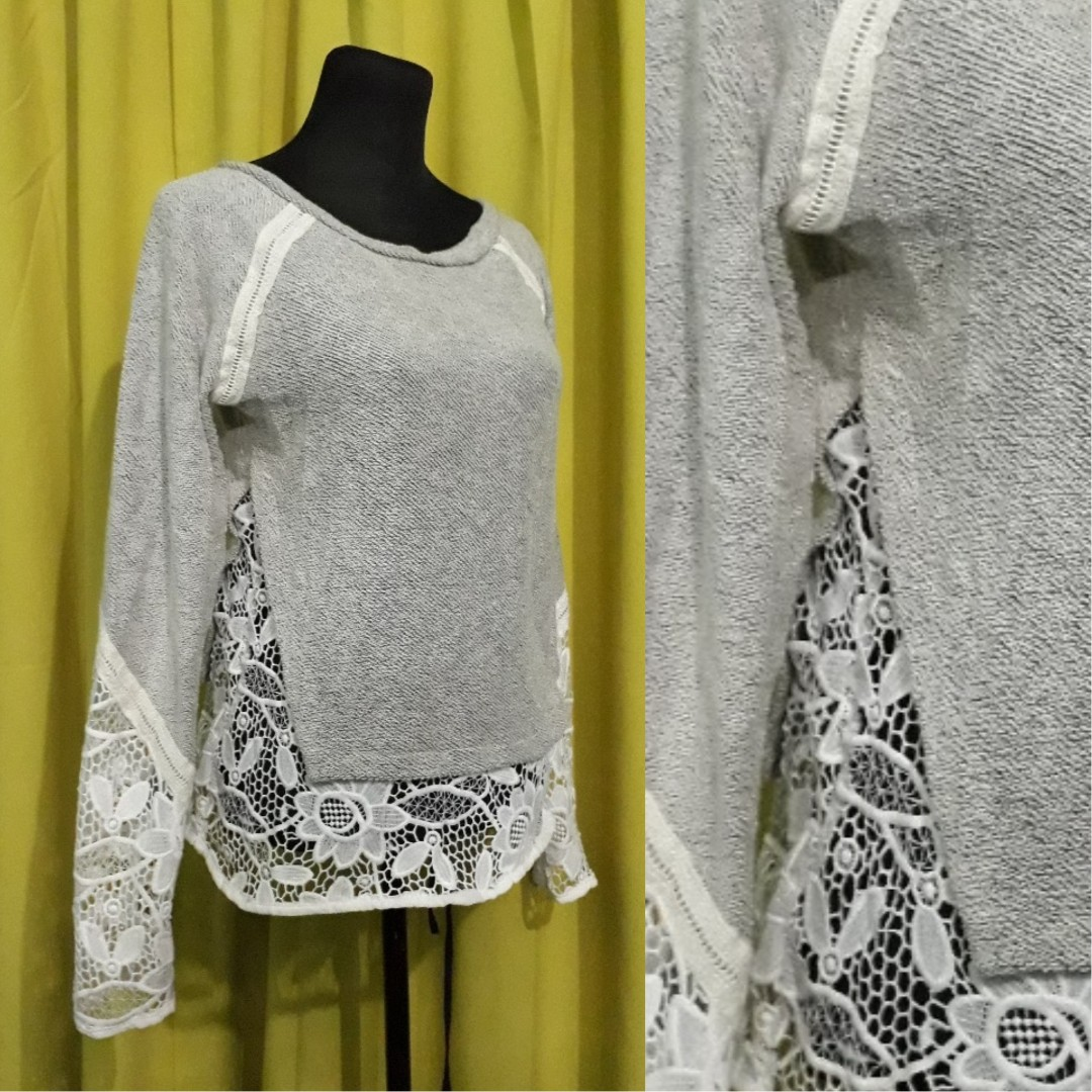 grey knitted pullover with large lace details