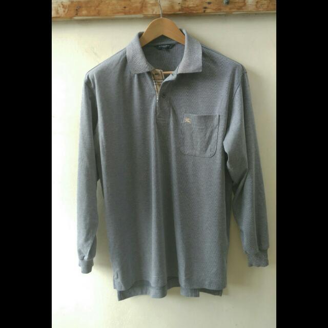 Kaos Poloshirt BURBERRY ORIGINAL - Polo Shirt Lengan Panjang Burberry Original.  Size Fit untuk yang biasa memakai L / XL Indonesia. silahkan dicocokkan ukurannya gan : Lebar bahu 48cm, lebar dada 57cm, panjang 69cm.
