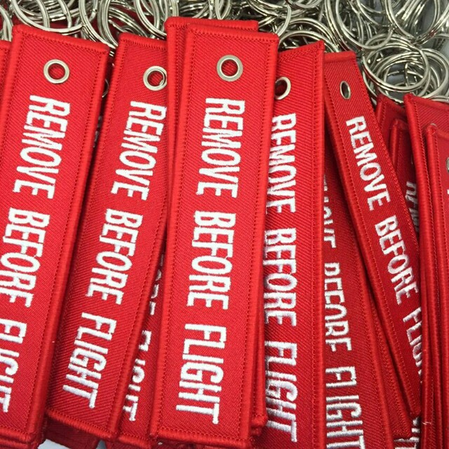 Remove before flight embroidery key tags