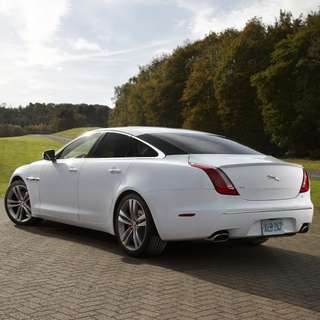 White Jaguar XJ L wedding car