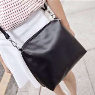 Plain black leather sling bag