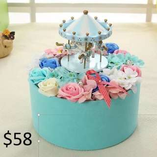 BRAN NEW Merry go round valentine day flower!!! MERRY go round include battery and music!!! It is a miniture merry go round that will go round and round!!! tag Hello kitty flower, valentine's flower