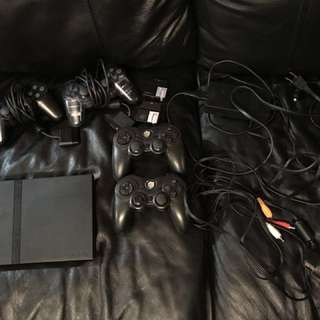 Playstation 2 with 4 controllers + memory card + 20 games