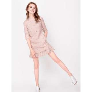 In a Flutter Hem Dress