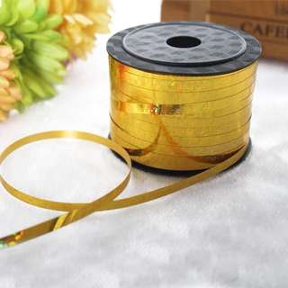 Gold sparkly ribbon roll