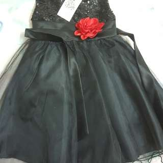 Black dress with red flower