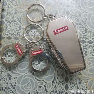 supreme Handcuffs  and Coffin keychain silver.