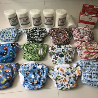 12 sets of cloth diapers including 2 inserts each + 5 rolls of bamboo liners + freebies