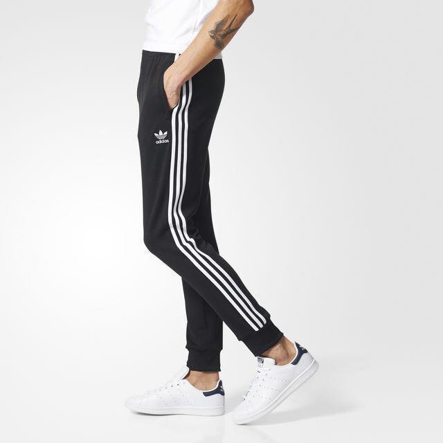 Adidas Originals Superstar esposado los pantalones de la pista, la moda masculina