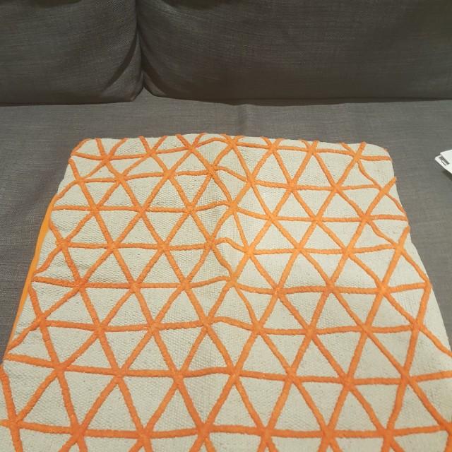 Orange patterned cushion
