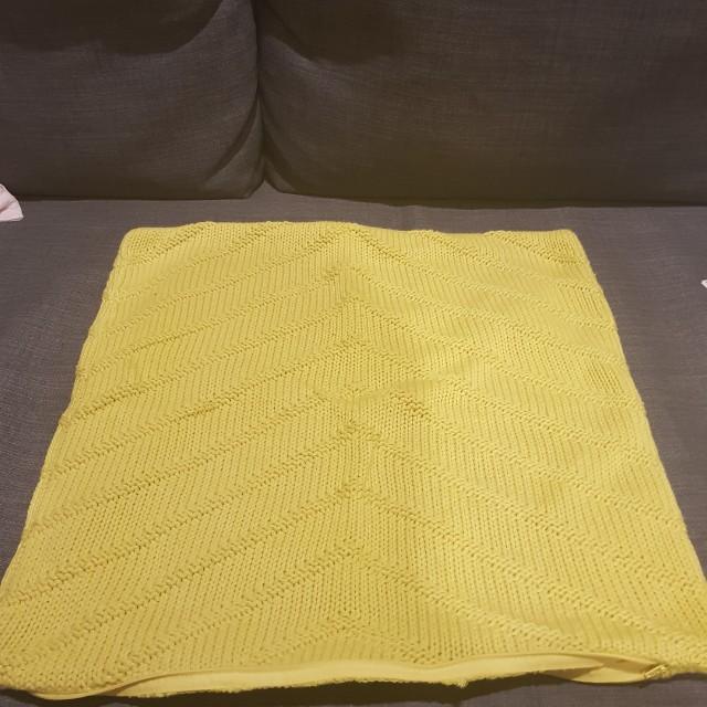 Yellow knit cushion
