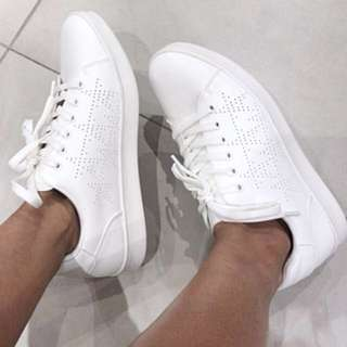 White perforated stars shoes