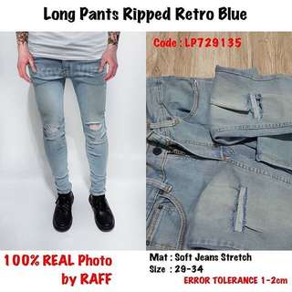 Ripped Retro Blue Jeans