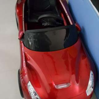 Electronic Toy Car Red; battery operated used only less than a year. with some scratches