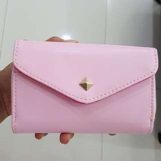 Women pink pouch