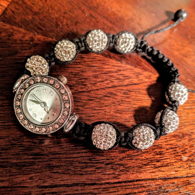 Watch with gems and adjustable strap