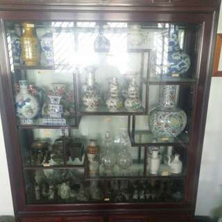 Cabinet full of beautiful dynasty vases