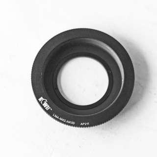 Kiwi M42-Nikon adapter ring with corrective/infinity glass lens