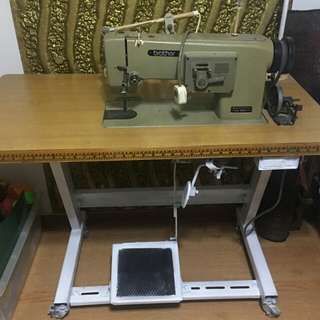 Industrial sewing machine with counter table