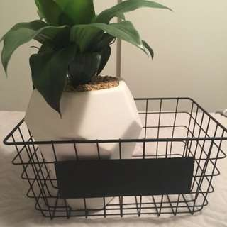 Fake flower pot with a basket