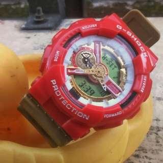 Jam tangan Casio G-shock warna merah-emas