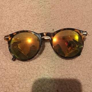 Orange/red reflector sunglasses