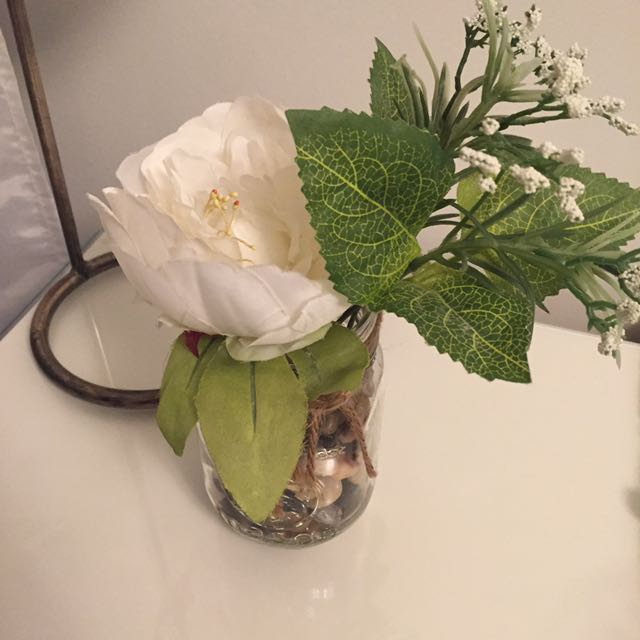 Floral mason jar filled with stones