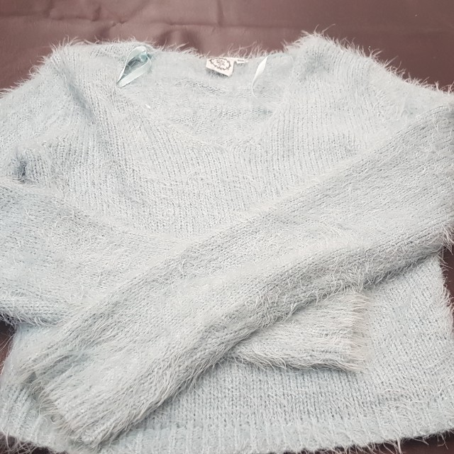 Never worn. Fluffy cropped top. Fits 6/8