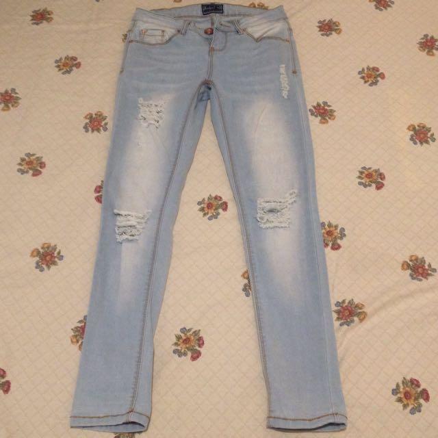 Tattered Skinny Jeans