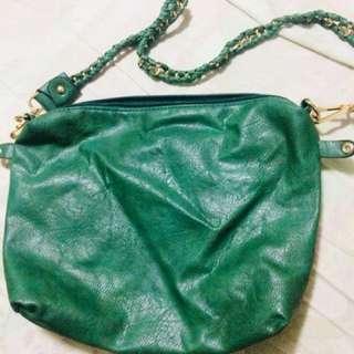 Green leather sling bag