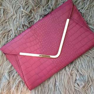 Plum coloured envelope clutch