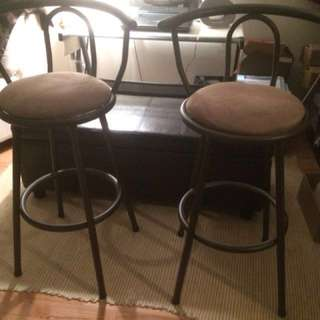 Two espresso swivel stools