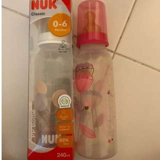 1 brand new in box nuk latex 240ml bottle and 1 lightly used bottle