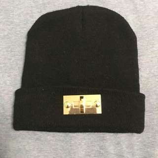 Black beanie with gold embellishment