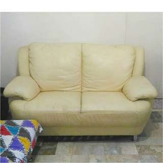 Creamy yellow 2-seater faux leather sofa