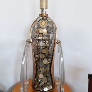 Courvoisier bottle with coins
