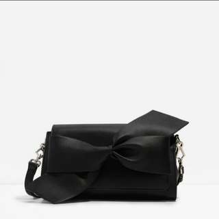 CK OVERSIZED KNOTED CLUTCH