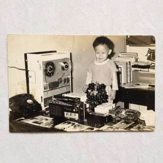 Vintage Old Photo - Old black & White Photograph showing a kid with lots of Vintage Stuffs (14 by 9 cm)