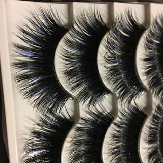 Fake lashes with blue streaks