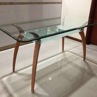 Classy tempered-glass dining table