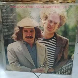 SIMON & GARFUNKEL GREATEST HITS G WITH DENT AND SEMI WARF WOBBLES WHEN PLAYED