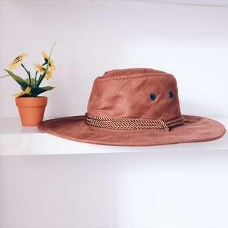 Brown brim hat