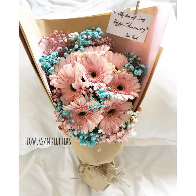 Pink gerbera daisy flower bouquet wraps with mixed pink, blue and ...
