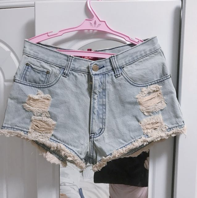 Tattered ripped denim shorts
